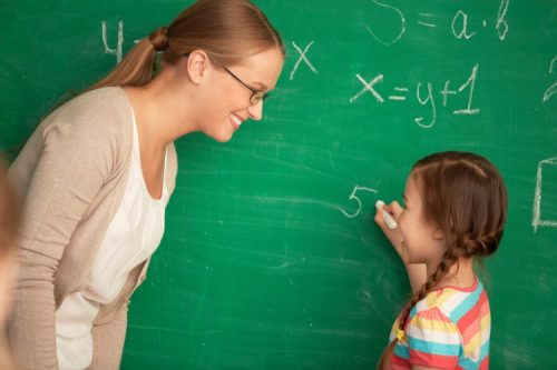 math-teacher-and-student-500×333